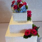 square white wedding cake with flowers
