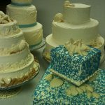 multiple beach themed wedding cakes