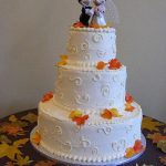 mickey and minnie on a wedding cake top