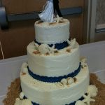 wedding cake with sand and shells