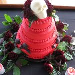 red cake with skull on it