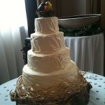 wedding cake on log with birds
