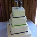white and blue wedding cake with a D