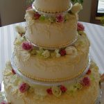 flowers and frilly wedding cake