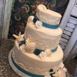 blue and white cake with shells