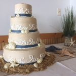 cake decorated with shells and starfish