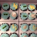 blue cupcakes flip flops and sea shells on top