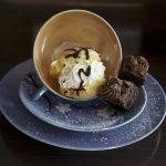 chocolate and cream puffs on blue mug