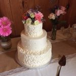 3 tiered cake with flowers on top